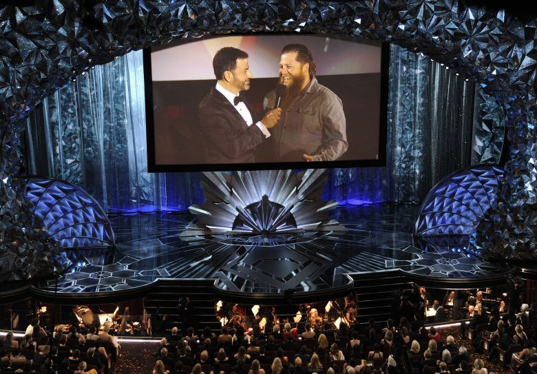 Host Jimmy Kimmel, left, speaks with a member of the movie theater audience on screen via satellite at the Oscars, at the Dolby Theatre in Los Angeles90th Academy Awards - Show, Los Angeles, USA - 04 Mar 2018