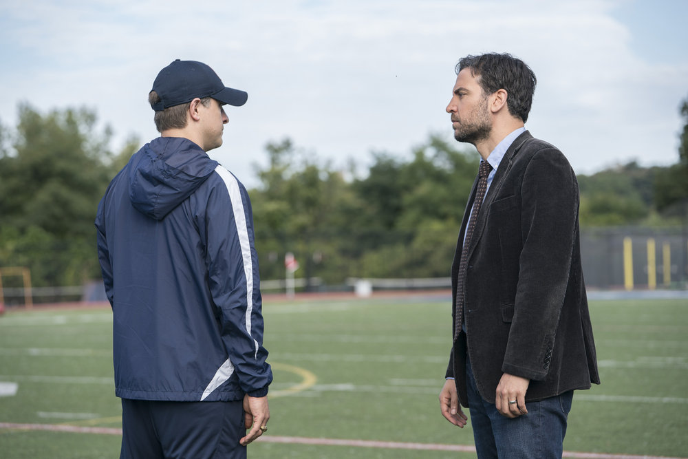 "RISE -- ""Most of All to Dream"" Episode 102 -- Pictured: (l-r) Joe Tippett as Coach Doug Strickland, Josh Radnor as Lou Mazzuchelli -- (Photo by: Peter Kramer/NBC)"