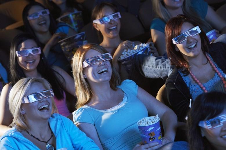 MODEL RELEASED Audience Watching 3-D MovieCinema