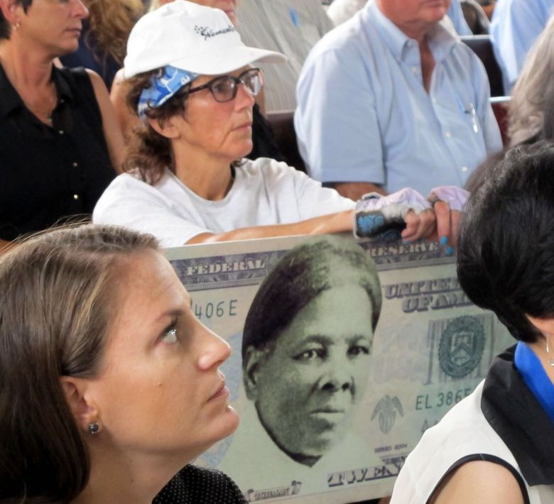 A woman holds a sign supporting Harriet Tubman for the $20 bill, during a town hall meeting at the Women's Rights National Historical Park in Seneca Falls, N.Y. Although the meeting with U.S. Treasurer Rosie Rios was part of plans to redesign the $10 bill, several in attendance said they wanted to see a woman on the $20 bill, tooCurrency Redesign, Seneca Falls, USA