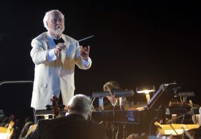 John Williams Composer and conductor John Williams leads the Orlando Philharmonic Orchestra during the grand opening celebration at the Wizarding World of Harry Potter at Universal Orlando Resort theme park in Orlando, Fla., . Williams has composed many film scores, including Star Wars, Superman, Home Alone, the first three Harry Potter movies and many Steven Spielberg's feature films including the Indiana Jones series, Schindler's List, E.T. the Extra-Terrestrial, Jurassic Park and JawsHarry Potter Park, Orlando, USA