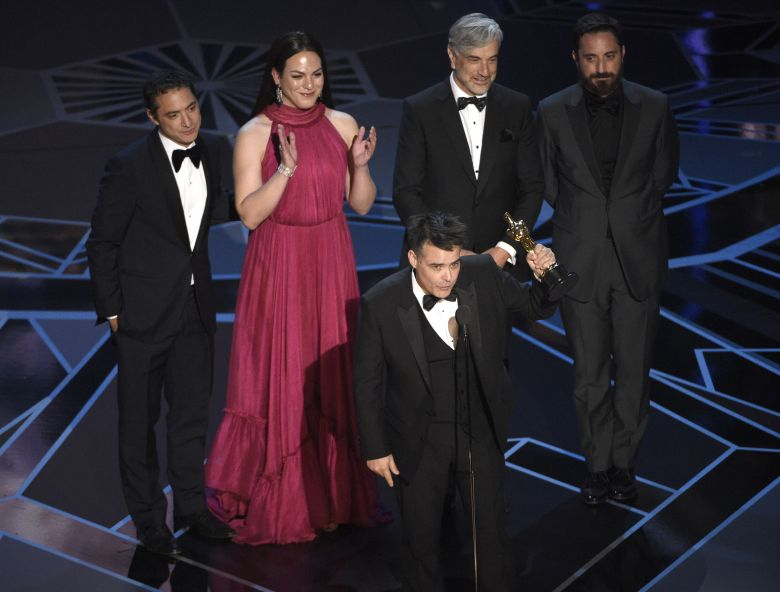 """Sebastian Lelio, Nicolas Saavedra, Daniela Vega, Alejandro Goic, Pablo Larrain. Sebastian Lelio, foreground center, and Nicolas Saavedra, from back left, Daniela Vega, Alejandro Goic, and Pablo Larrain accept the award for best foreign language film for """"A Fantastic Woman"""" at the Oscars, at the Dolby Theatre in Los Angeles90th Academy Awards - Show, Los Angeles, USA - 04 Mar 2018"""