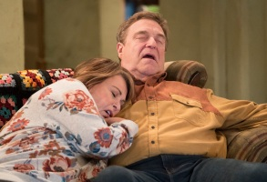 """ROSEANNE - """"Roseanne Gets the Chair"""" - Roseanne's clash with Darlene over how she's raising her kids - especially Harris - reaches a breaking point; while Dan tries to help Roseanne with her bad knee by getting her an elevator chair, which she refuses to use because she doesn't want to admit getting old, on the second episode of the revival of """"Roseanne,"""" TUESDAY, APRIL 3 (8:00-8:30 p.m. EDT), on The ABC Television Network. (ABC/Adam Rose)ROSEANNE BARR, JOHN GOODMAN"""