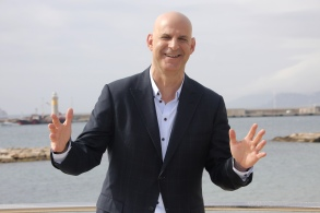 """American author Harlan Coben poses for photographers during the MIPTV, International Television Programme Market in Cannes, southern France. Coben, is changing publishers. Grand Central Publishing told The Associated Press on Thursday that it had reached a 5-book deal. Coben's books have more than 70 million copies in print worldwide. He has also developed the TV series """"The Five"""" and the upcoming Netflix drama """"Safe,"""" which premieres in AprilBooks-Harlan Coben, Cannes, France - 04 Apr 2016"""