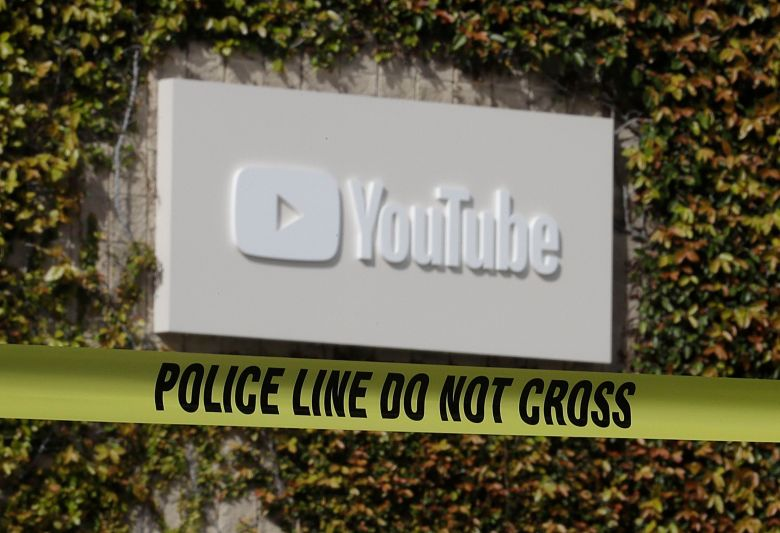 Police tape is shown outside of a YouTube office building in San Bruno, Calif., . A woman suspected of shooting three people at YouTube headquarters before killing herself was furious with the company because it had stopped paying her for videos she posted on the platform, her father said Tuesday, April 3, 2018YouTube Shooting, San Bruno, USA - 04 Apr 2018