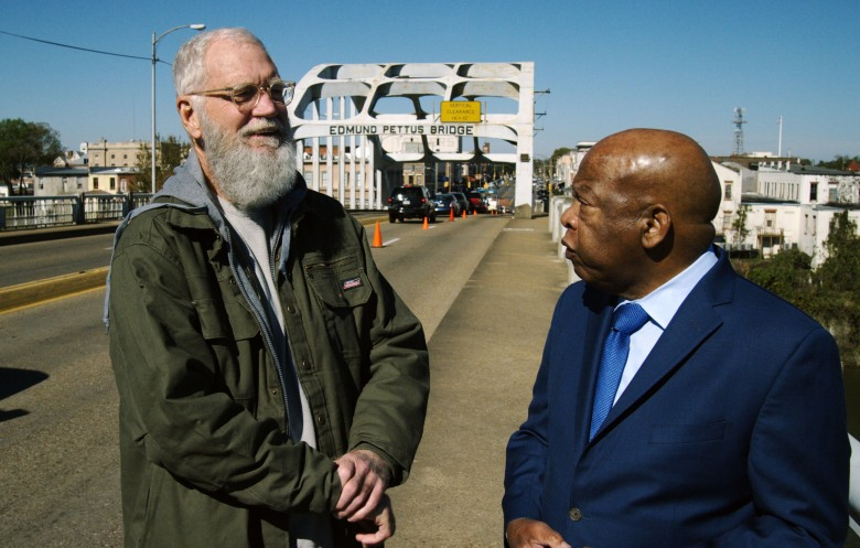David Letterman (left) and Congressman John Lewis walk across the Edmund Pettus Bridge in Selma, Alabama during the premiere episode of My Next Guest Needs No Introduction with David Letterman.