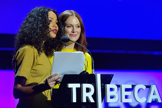 "NEW YORK, NY - APRIL 28: Jurnee Smollett-Bell and Julianne Moore speak onstage at ""Time's Up"" during the 2018 Tribeca Film Festival at Spring Studios on April 28, 2018 in New York City. (Photo by Roy Rochlin/Getty Images for Tribeca Film Festival)"