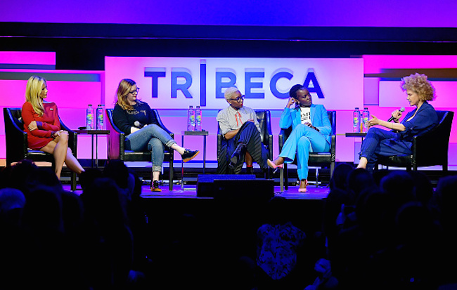 """NEW YORK, NY - APRIL 28:  (L-R) Mira Sorvino, Amber Tamblyn, Cynthia Erivo, Lupita Nyong'o and Michaela Angela Davis speak onstage at """"Time's Up"""" during the 2018 Tribeca Film Festival at Spring Studios on April 28, 2018 in New York City.  (Photo by Roy Rochlin/Getty Images for Tribeca Film Festival)"""