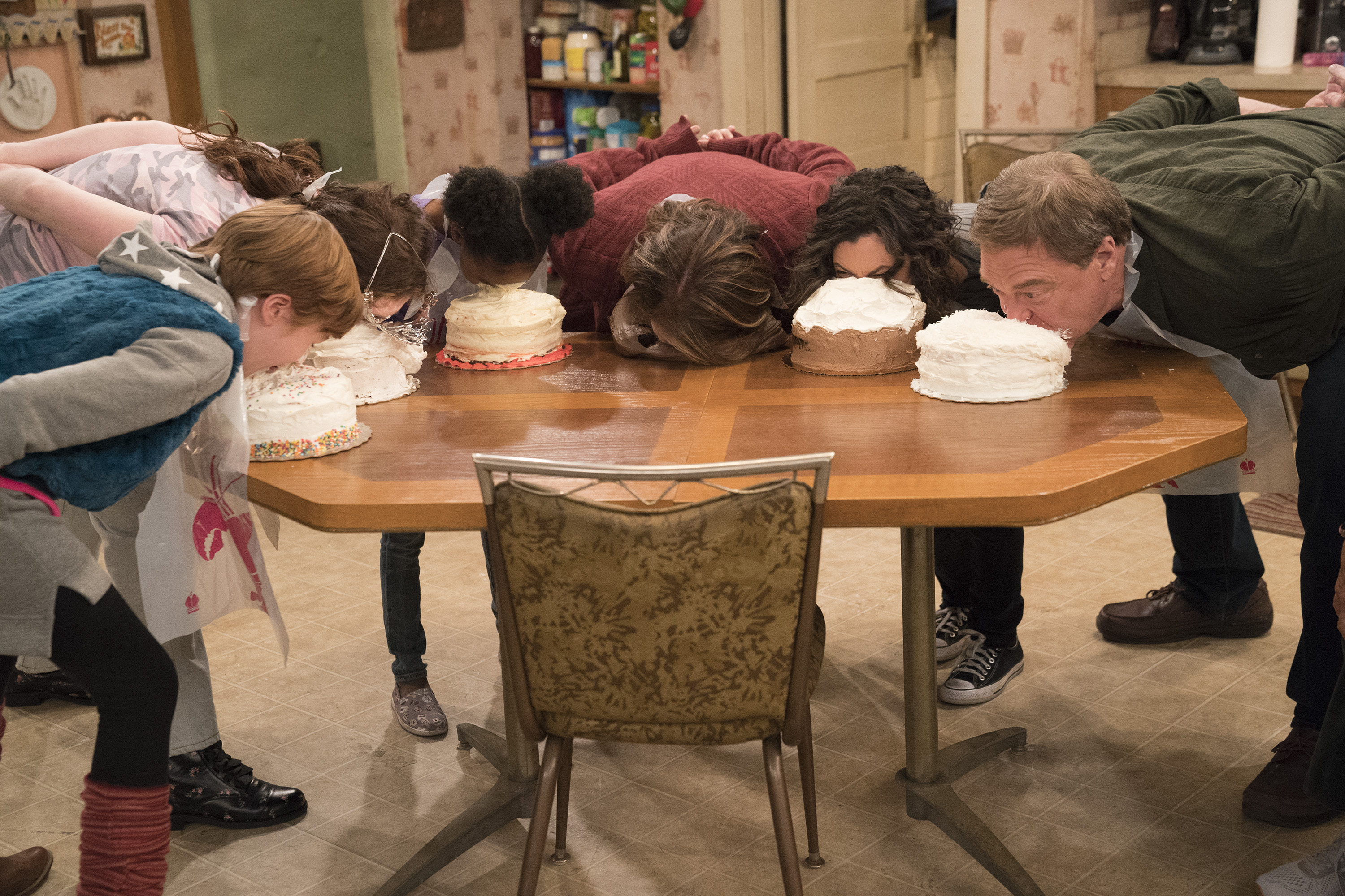 """ROSEANNE - """"Darlene v. David"""" - David unexpectedly shows up for Harris' birthday after being absent for years, forcing Darlene to re-examine their relationship and the rest of the family. Meanwhile, Roseanne and Jackie's mother, Bev, temporarily moves into the Conner home after an incident at the nursing home prevents her from returning, on the fifth episode of the revival of """"Roseanne,"""" TUESDAY, APRIL 17 (8:00-8:30 p.m. EDT), on The ABC Television Network. (ABC/Greg Gayne)AMES MCNAMARA, EMMA KENNEY, JAYDEN REY, ROSEANNE BARR, SARA GILBERT, JOHN GOODMAN"""