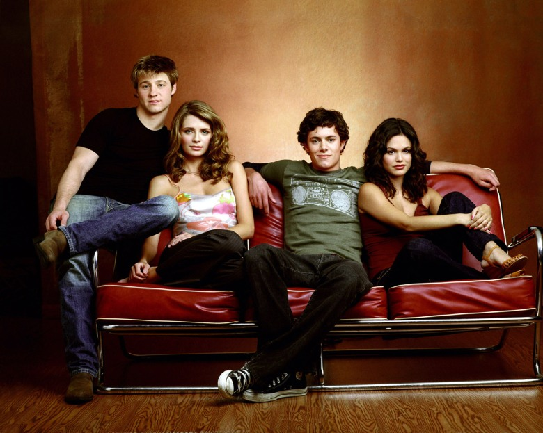 No Merchandising. Editorial Use Only. No Book Cover UsageMandatory Credit: Photo by Snap Stills/REX/Shutterstock (2168813a) Benjamin McKenzie as Ryan, Mischa Barton as Marissa, Adam Brody as Seth and Rachel Bilson as Summer; all seated on couch. The O.C - 2004