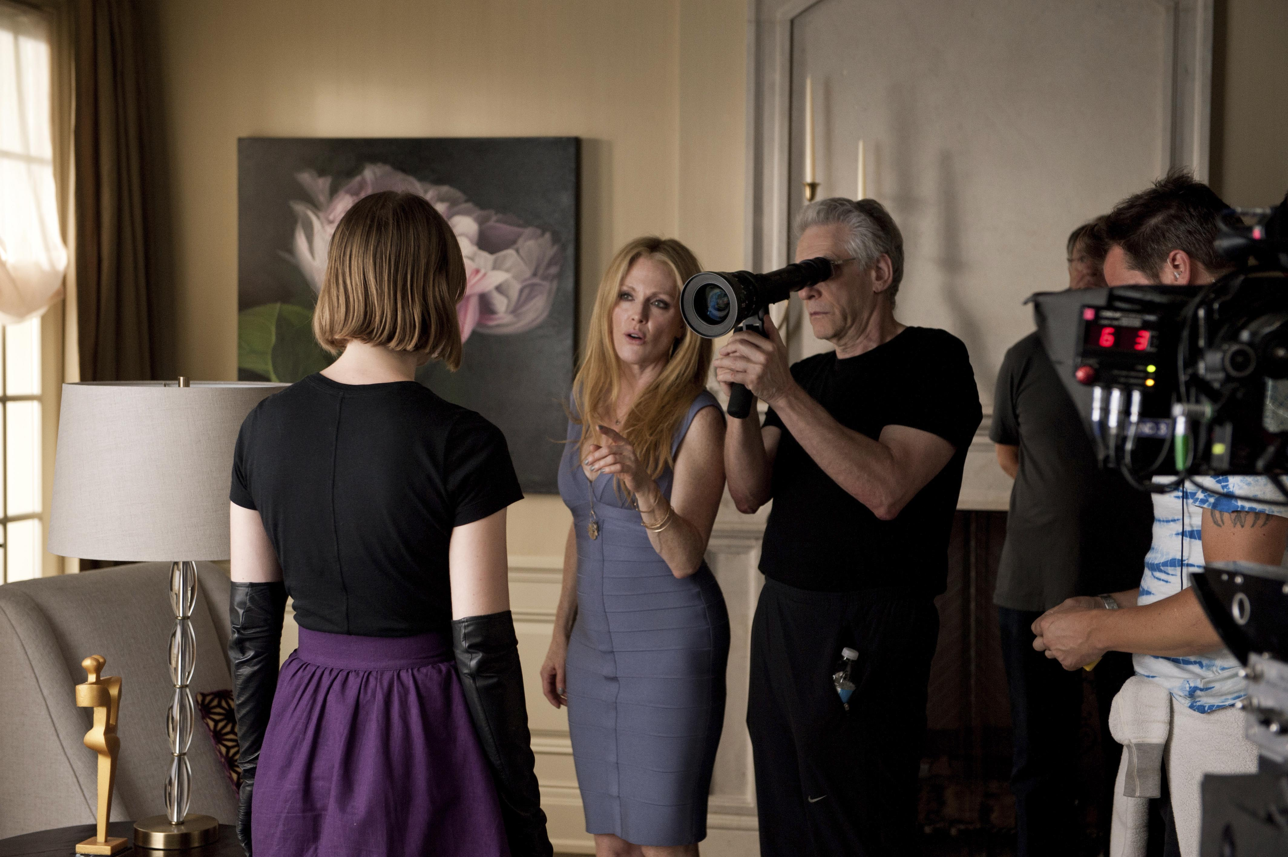 No Merchandising. Editorial Use Only. No Book Cover Usage.Mandatory Credit: Photo by Caitlin Cronenberg/Prospero/Sentient/Sbs Prods./Integral Film/Kobal/REX/Shutterstock (5883930s) Mia Wasikowska, Julianne Moore, David Cronenberg Maps To The Stars - 2014 Director: David Cronenberg Prospero Pictures / Sentient Entertainment / Sbs Productions / Integral Film USA / CANADA On/Off Set