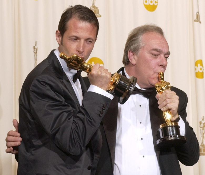 "LESTRADE PONCET Jean-Xavier de Lestrade, left, and Denis Poncet kiss their Oscars for best documentary feature for the film ""Murder on a Sunday Morning"" during the 74th annual Academy Awards, in Los Angeles. Their film about the case of 16-year-old Brenton Butler, who was facing trial for a 2000 murder in Jacksonville, Fla., airs this Sunday on HBOOSCARS DOCUMENTARY, LOS ANGELES, USA"