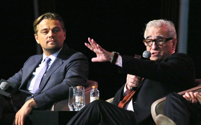 Leonardo DiCaprio, Martin Scorsese Film star Leonardo DiCaprio, left, and director Martin Scorsese speaks during a news conference in MacauMacau Slump