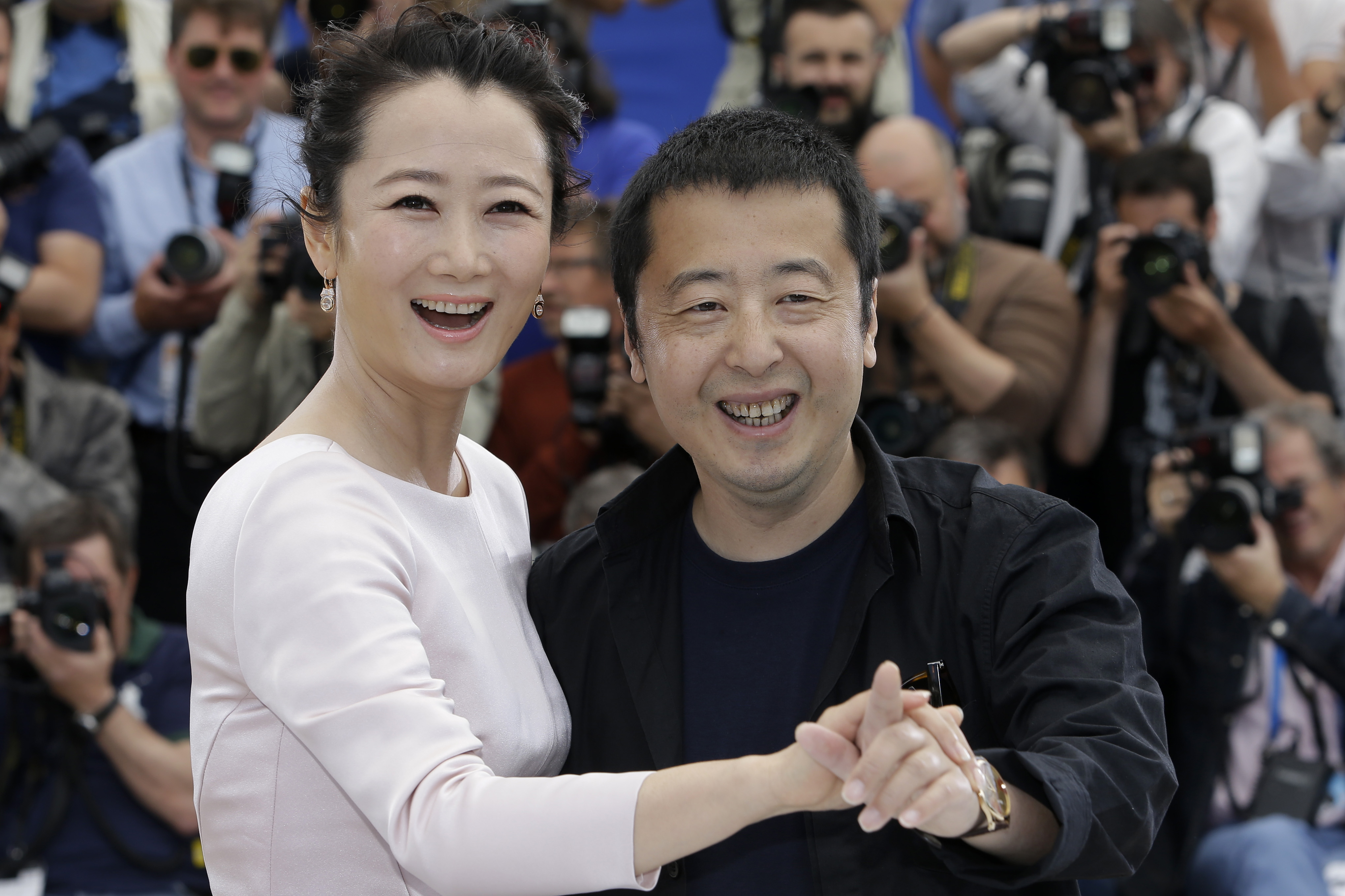 Actress Zhao Tao, left, and director Jia Zhangke pose for photographers during a photo call for the film Shan He Gu Ren (Mountains May Depart), at the 68th international film festival, Cannes, southern France France Cannes Mountains May Depart Photo Call, Cannes, France