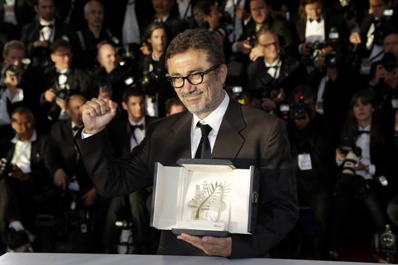 Director Nuri Bilge Ceylan poses with the Palme d'Or award for the film Winter Sleep during a photo call following the awards ceremony at the 67th international film festival, Cannes, southern FranceFrance Cannes Awards Photo Call, Cannes, France