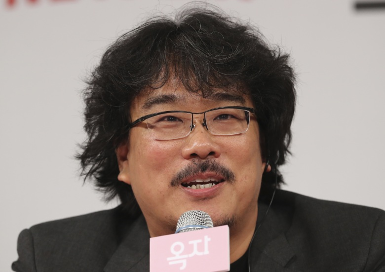 "Copyright 2017 The Associated Press. All rights reserved. This material may not be published, broadcast, rewritten or redistributed without permission.Mandatory Credit: Photo by AP/REX/Shutterstock (8866695a)South Korean director Bong Joon-ho answers a reporter's question during the press conference for his latest film ""Okja"" in Seoul, South KoreaFilm Okja, Seoul, South Korea - 14 Jun 2017"