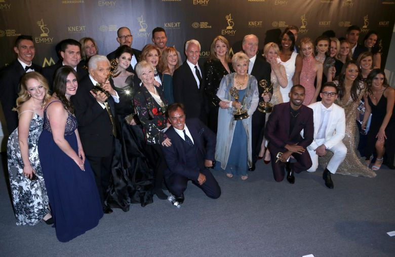 """The cast and crew of """"Days of Our Lives"""" pose in the press room with the award for outstanding drama series at the 45th annual Daytime Emmy Awards at the Pasadena Civic Center, in Pasadena, Calif45th Annual Daytime Emmy Awards - Press Room, Pasadena, USA - 29 Apr 2018"""