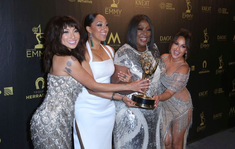 Jeannie Mai, Tamera Mowry-Housley, Loni Love, Adrienne Houghton. Jeannie Mai, from left, Tamera Mowry-Housley, Loni Love and Adrienne Houghton pose in the press room with the Award for Outstanding Entertainment Talk Show for