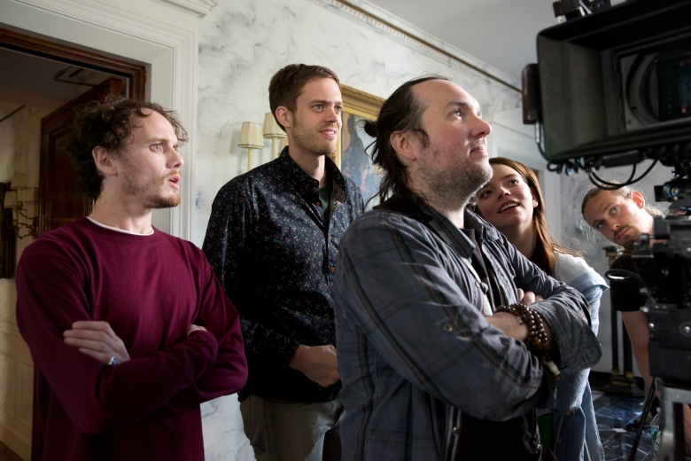 "Anton Yelchin, Director Cory Finley, Director of Photography Lyle Vincent and Anya Taylor-Joy on the set of ""Thoroughbreds"""