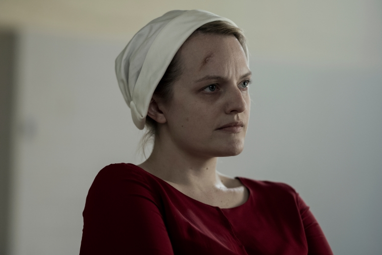 """THE HANDMAID'S TALE -- """"June"""" -- Episode 201 -- Offred reckons with the consequences of a dangerous decision while haunted by memories from her past and the violent beginnings of Gilead. Offred (Elisabeth Moss), shown. (Photo by:George Kraychyk/Hulu)"""