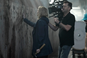"THE HANDMAID'S TALE -- ""Unwomen"" --Episode 202 -- Offred adjusts to a new way of life. The arrival of an unexpected person disrupts the Colonies. A family is torn apart by the rise of Gilead. Behind the scenes Offred (Elisabeth Moss) and Director of Photography Colin Watkinson, shown.  (Photo by: George Kraychyk/Hulu)"