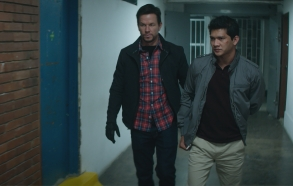 Mark Wahlberg, as Ground Branch officer Jimmy Silva, and Iko Uwais, as Li Noor, star in the STXfilms MILE 22.