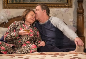 "ROSEANNE - ""Knee Deep"" - Roseanne's knee gets worse so Dan is forced to a make an important work decision; but when a major storm hits Lanford, their fortunes change for the better. Later, Darlene realizes she has to go back to her first passion . writing, on the ninth episode and season finale of the revival of ""Roseanne,"" TUESDAY, MAY 22 (8:00-8:30 p.m. EDT), on The ABC Television Network. (ABC/Adam Rose)ROSEANNE BARR, JOHN GOODMAN"