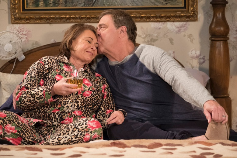 """ROSEANNE - """"Knee Deep"""" - Roseanne's knee gets worse so Dan is forced to a make an important work decision; but when a major storm hits Lanford, their fortunes change for the better. Later, Darlene realizes she has to go back to her first passion . writing, on the ninth episode and season finale of the revival of """"Roseanne,"""" TUESDAY, MAY 22 (8:00-8:30 p.m. EDT), on The ABC Television Network. (ABC/Adam Rose)ROSEANNE BARR, JOHN GOODMAN"""