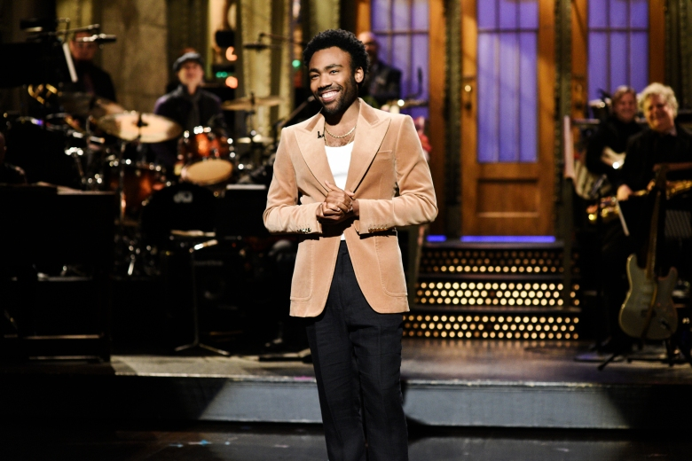 """SATURDAY NIGHT LIVE -- """"Donald Glover"""" Episode 1744 -- Pictured: Host Donald Glover during the opening monologue in Studio 8H on Saturday, May 5, 2018 -- (Photo by: Will Heath/NBC)"""