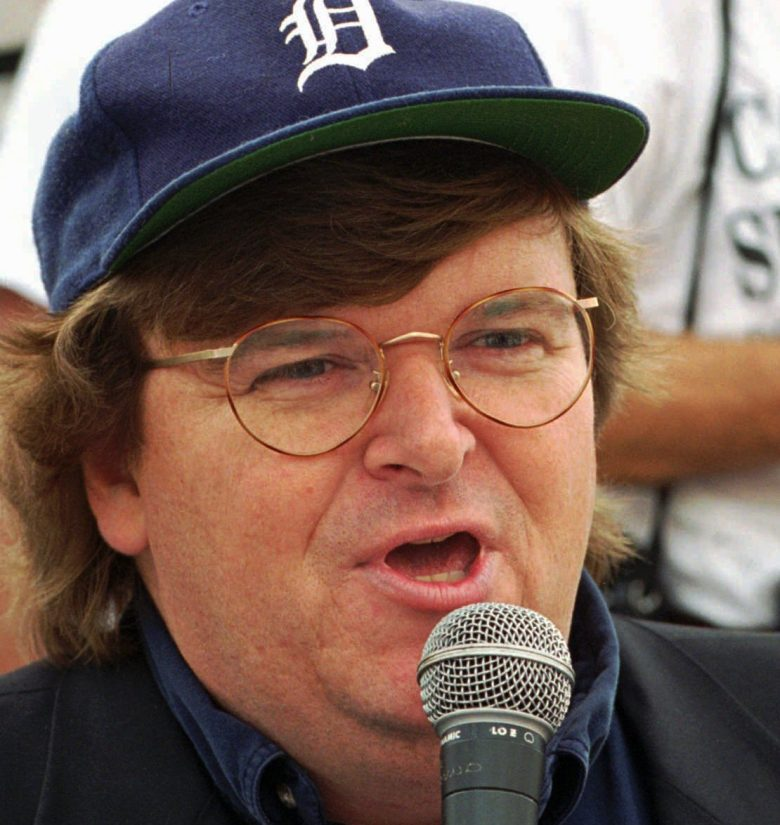 "MICHAEL MOORE The man behind the movie ''Roger & Me"" and the host of Fox's now-canceled ''TV Nation'' program, is writing a book poking fun at contemporary American life, his hometown newspaper, The Flint Journal, reported. The book is tentatively titled ''Downsize This! Random Threats From an Unarmed American'', to be published by Crown Publishers, a division of Random House IncNAMES MOORE, DETROIT, USA"