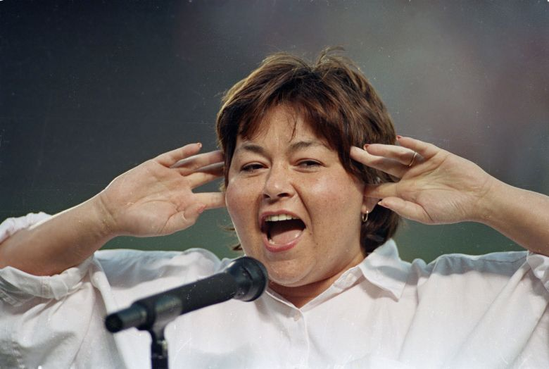 Barr Comedienne Roseanne Barr holds her fingers in her ears as she screams the National Anthem between games of the San Diego Padres and the Cincinnati Reds doubleheader on in San Diego, Calif. She was booed loudly and she made an obscene gesture and spat when she was finishedROSEANNE BARR NATIONAL ANTHEM, SAN DIEGO, USA