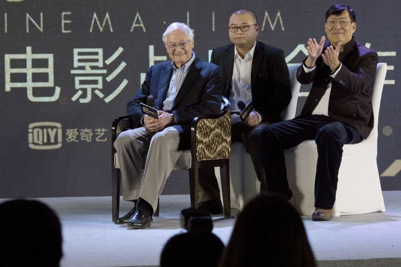 "American film producer Roger Corman, left, attends a news conference to announce co-production between Chinese online video site iQIYI and Sony Pictures in Beijing, China, . The 90-year-old American producer of films including ""The St. Valentine's Day Massacre"" and ""Attack of the 50 Foot Cheerleader"" will lead a team of young Chinese filmmakers and act as producer on a sci-fi film made for viewing on the internet or mobile phone called ""InvasioniQiyi Sony, Beijing, China - 01 Dec 2016"