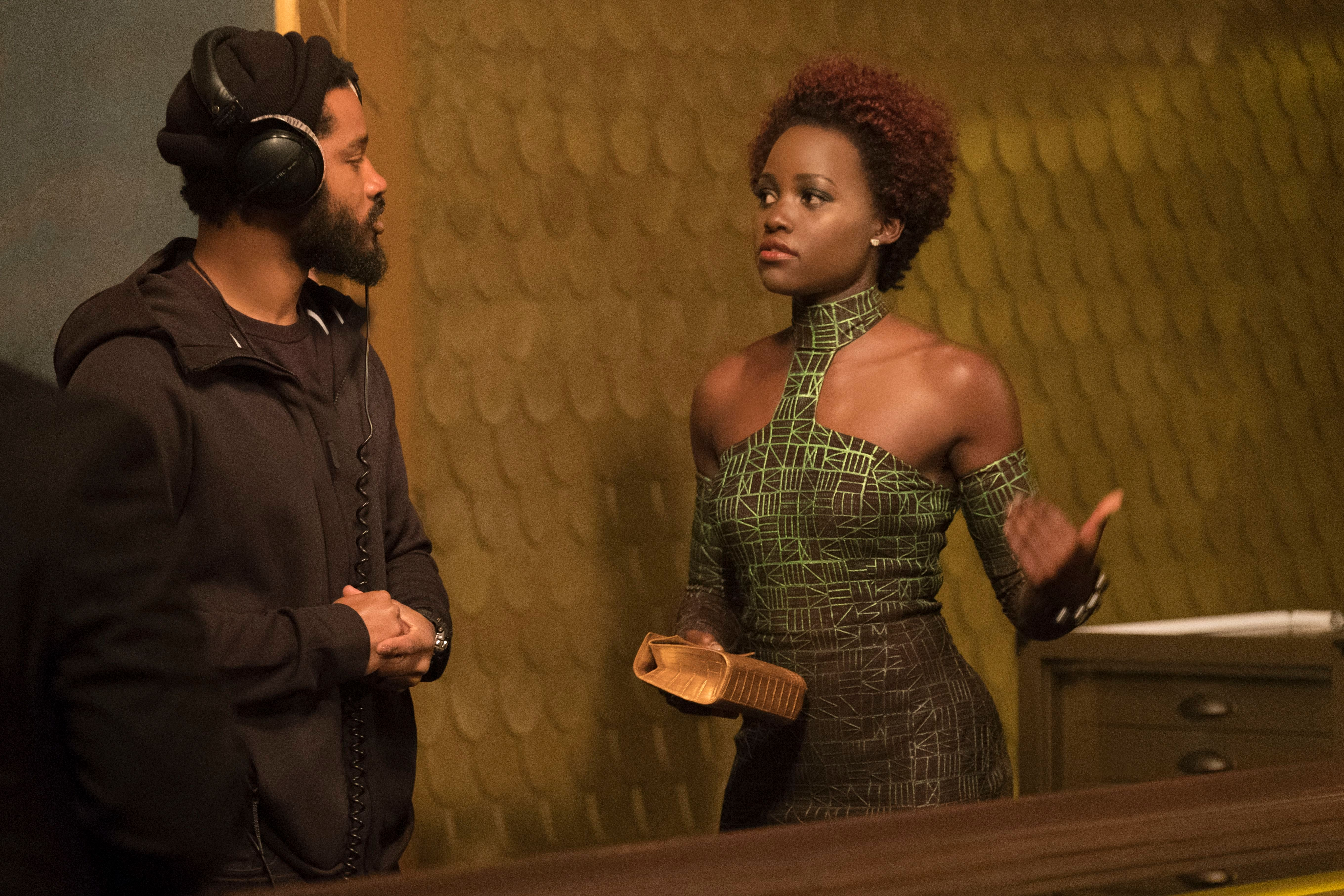 "No Merchandising. Editorial Use Only. No Book Cover UsageMandatory Credit: Photo by Marvel/Disney/Kobal/REX/Shutterstock (9360960bz)Ryan Coogler, Lupita Nyong'o""Black Panther"" Film - 2018"