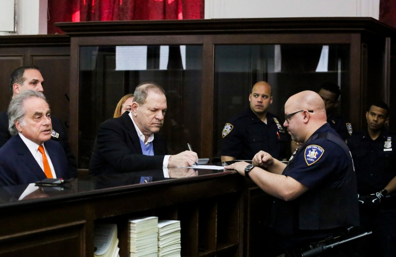 Harvey Weinstein and Benjamin BrafmanHarvey Weinstein arrested in New York, USA - 25 May 2018 Harvey Weinstein (C) Harvey Weinstein signs papers with his attorney Benjamin Brafman (L) during his arraignment in a criminal courtroom where he was formally charged with multiple counts of sexual assault in New York, New York, USA, 25 May 2018. Weinstein is with facing three felony charges - first-degree rape, third-degree rape, and one out of a criminal sexual act in the first degree.