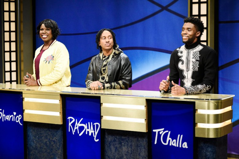 "SATURDAY NIGHT LIVE -- Episode 1742 ""Chadwick Boseman"" -- Pictured: (l-r) Leslie Jones as Shanice, Chris Redd as Rashad, Chadwick Boseman as T'Challa during 'Black Jeopardy' in Studio 8H on Saturday, April 7, 2018 -- (Photo by: Will Heath/NBC)"