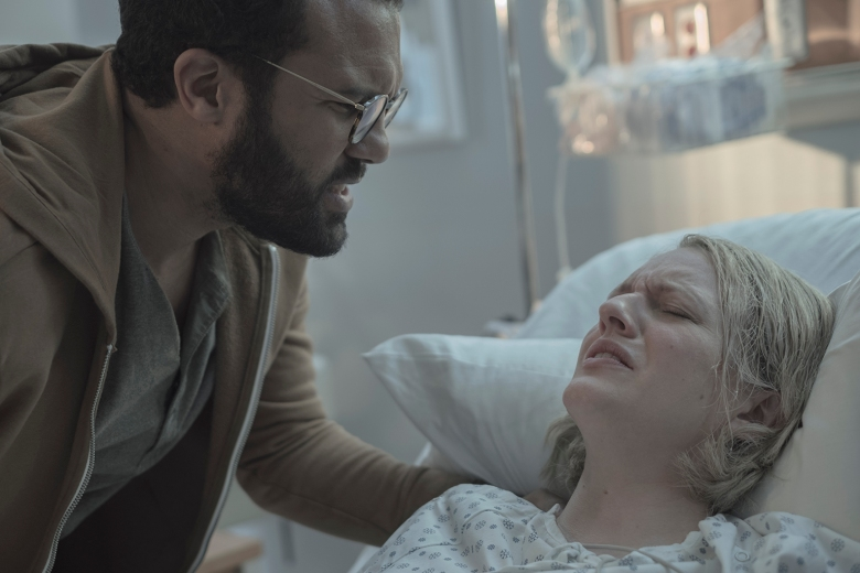 "THE HANDMAID'S TALE -- ""Holly"" -- Episode 211 -- Offred faces a grueling challenge alone as she recalls her life as a mother. Serena Joy and the Commander deal with the fallout of their actions towards Offred. Luke (O-T Fagbenle) and Offred (Elisabeth Moss), shown. (Photo by:George Kraychyk/Hulu)"