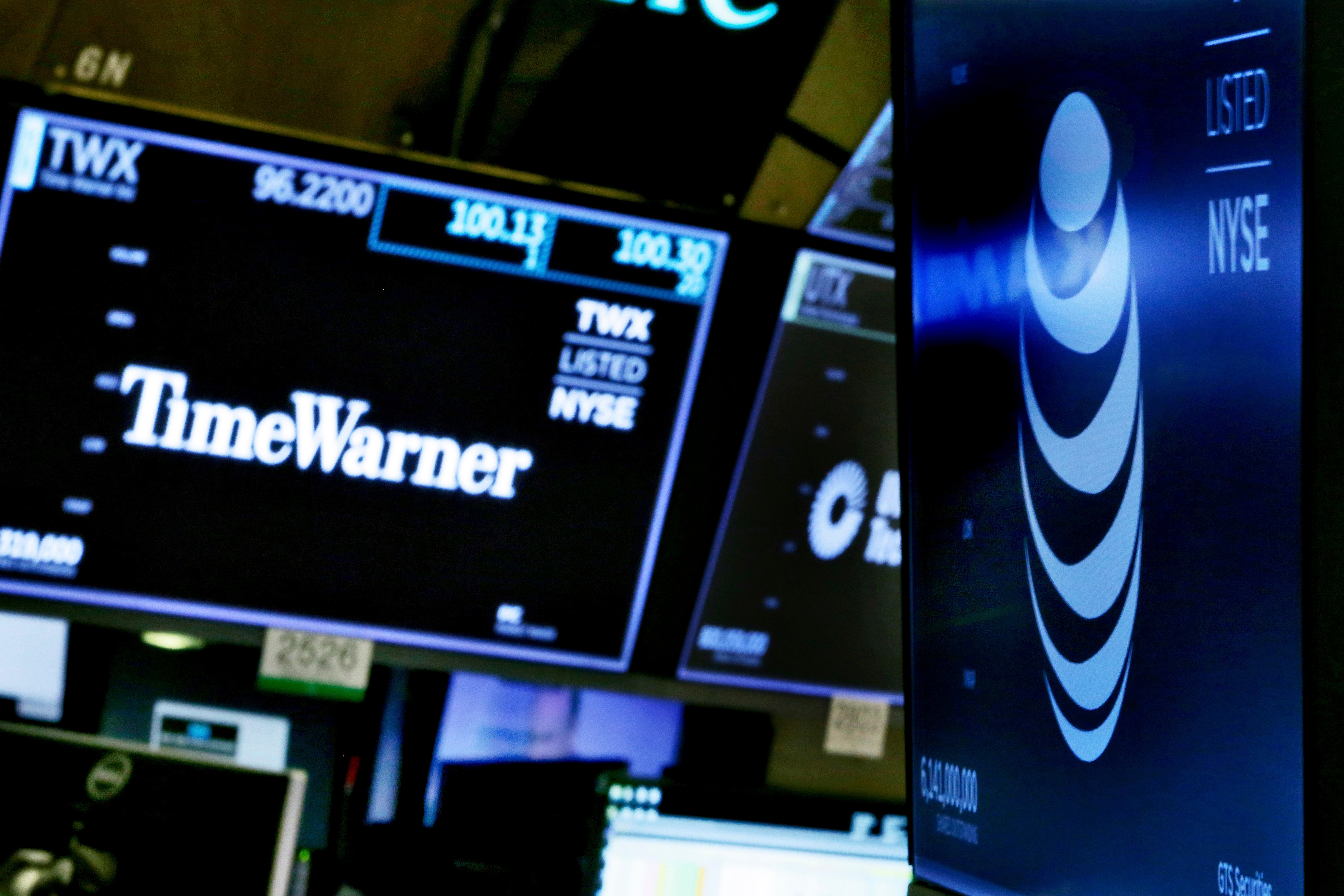 The logos for Time Warner and AT&T appear above alternate trading posts on the floor of the New York Stock Exchange, . A federal judge has approved the $85 billion mega-merger of AT&T and Time Warner, potentially ushering in a wave of media consolidation while shaping how much consumers pay for streaming TV and moviesFinancial Markets Wall Street AT T Time Warner Antitrust, New York, USA - 13 Jun 2018