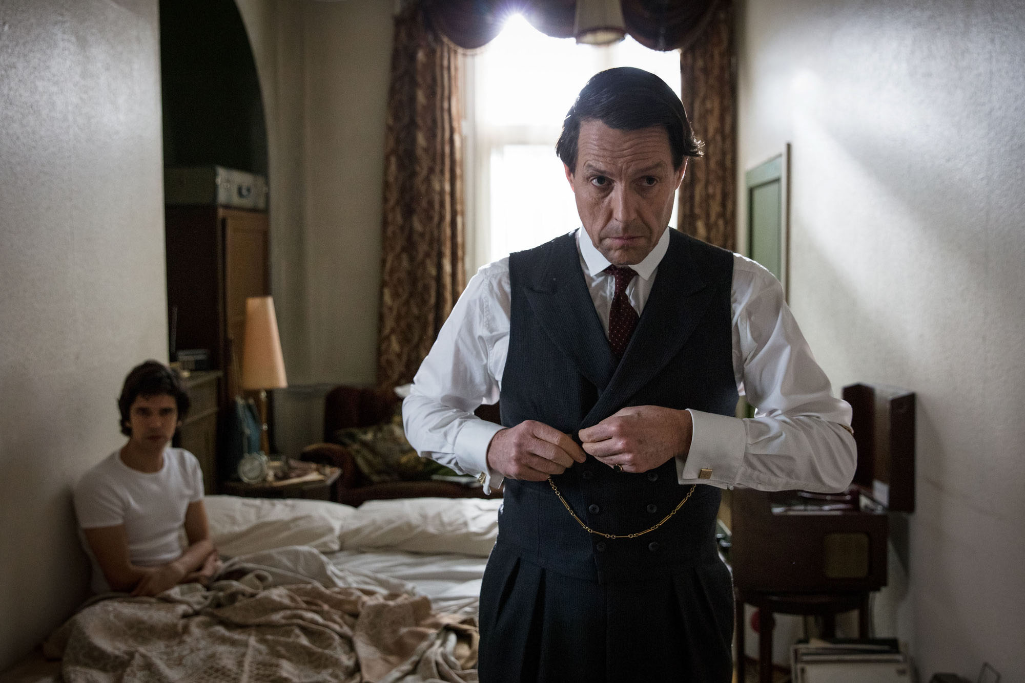 WARNING: Embargoed for publication until 00:00:01 on 06/04/2018 - Programme Name: A Very English Scandal - TX: n/a - Episode: n/a (No. 1) - Picture Shows: Norman Scott (BEN WHISHAW), Jeremy Thorpe (HUGH GRANT) - (C) Blueprint Television Ltd - Photographer: Sophie Mutevelian
