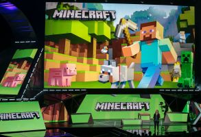 """Lydia Winters Lydia Winters, at podium, shows off Microsoft's """"Minecraft"""" built specifically for HoloLens during a live demo at the Xbox E3 2015 briefing ahead of the Electronic Entertainment Expo at the University of Southern California's Galen Center on in Los Angeles. Microsoft is promoting the next installment in its popular sci-fi franchise, """"Halo 5: Guardians,"""" at the Electronic Entertainment ExpoGames E3 Microsoft, Los Angeles, USA"""