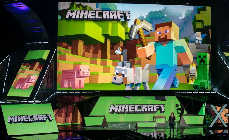 "Lydia Winters Lydia Winters, at podium, shows off Microsoft's ""Minecraft"" built specifically for HoloLens during a live demo at the Xbox E3 2015 briefing ahead of the Electronic Entertainment Expo at the University of Southern California's Galen Center on in Los Angeles. Microsoft is promoting the next installment in its popular sci-fi franchise, ""Halo 5: Guardians,"" at the Electronic Entertainment ExpoGames E3 Microsoft, Los Angeles, USA"