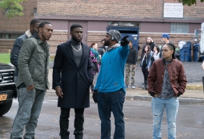 "(L to R) MO MCRAE as 7x7, JERMEL HOWARD as Lorenzo, Y'LAN NOEL as Dmitri, director GERARD MCMURRAY and SIYA as Blaise on the set of ""The First Purge."" Behind every tradition lies a revolution. This Independence Day, witness the rise of our country's 12 hours of annual lawlessness. Welcome to the movement that began as a simple experiment: ""The First Purge."""