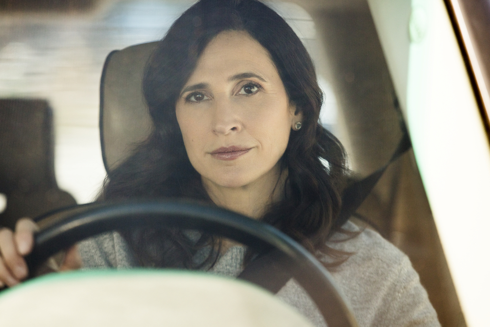 "CASUAL -- ""Polytropos"" - Episode 406 - Following a day of misguided decisions, Alex, Valerie, and Laura begin their overdue pilgrimage to Dawn's. But when their road trip takes an accidental turn, each faces an obstacle that tests their willpower in different ways. Valarie Meyers (Michaela Watkins) shown. (Photo by: Greg Lewis/Hulu)"