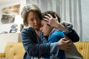 "THE SINNER -- ""Part II"" Episode 202 -- Pictured: (l-r) Carrie Coon as Vera Walker, Elisha Henig as Julian Walker -- (Photo by: Peter Kramer/USA Network)"