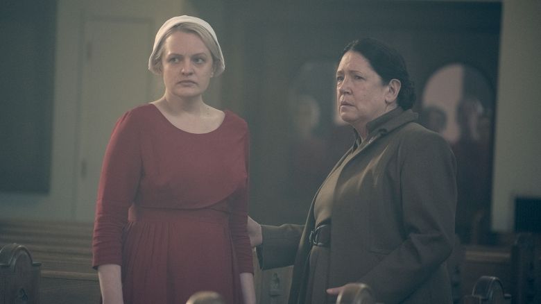 "THE HANDMAID'S TALE -- ""Postpartum"" -- Episode 212 -- Offred is sent to a familiar place. Nick is rocked by Gileadís brutal response to a crime. Emily is assigned to a mysterious new house. Offred (Elisabeth Moss) and Aunt Lydia (Ann Dowd), shown. (Photo by: George Kraychyk/Hulu)"