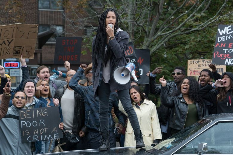"LEX SCOTT DAVIS as Nya in ""The First Purge."" Behind every tradition lies a revolution. This Independence Day, witness the rise of our country's 12 hours of annual lawlessness. Welcome to the movement that began as a simple experiment: ""The First Purge."""