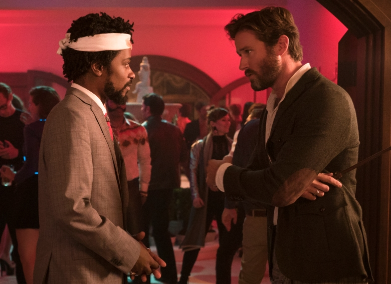(l to r.) Lakeith Stanfield as Cassius Green and Armie Hammer as Steve Lift star in Boots Riley's SORRY TO BOTHER YOU, an Annapurna Pictures release.