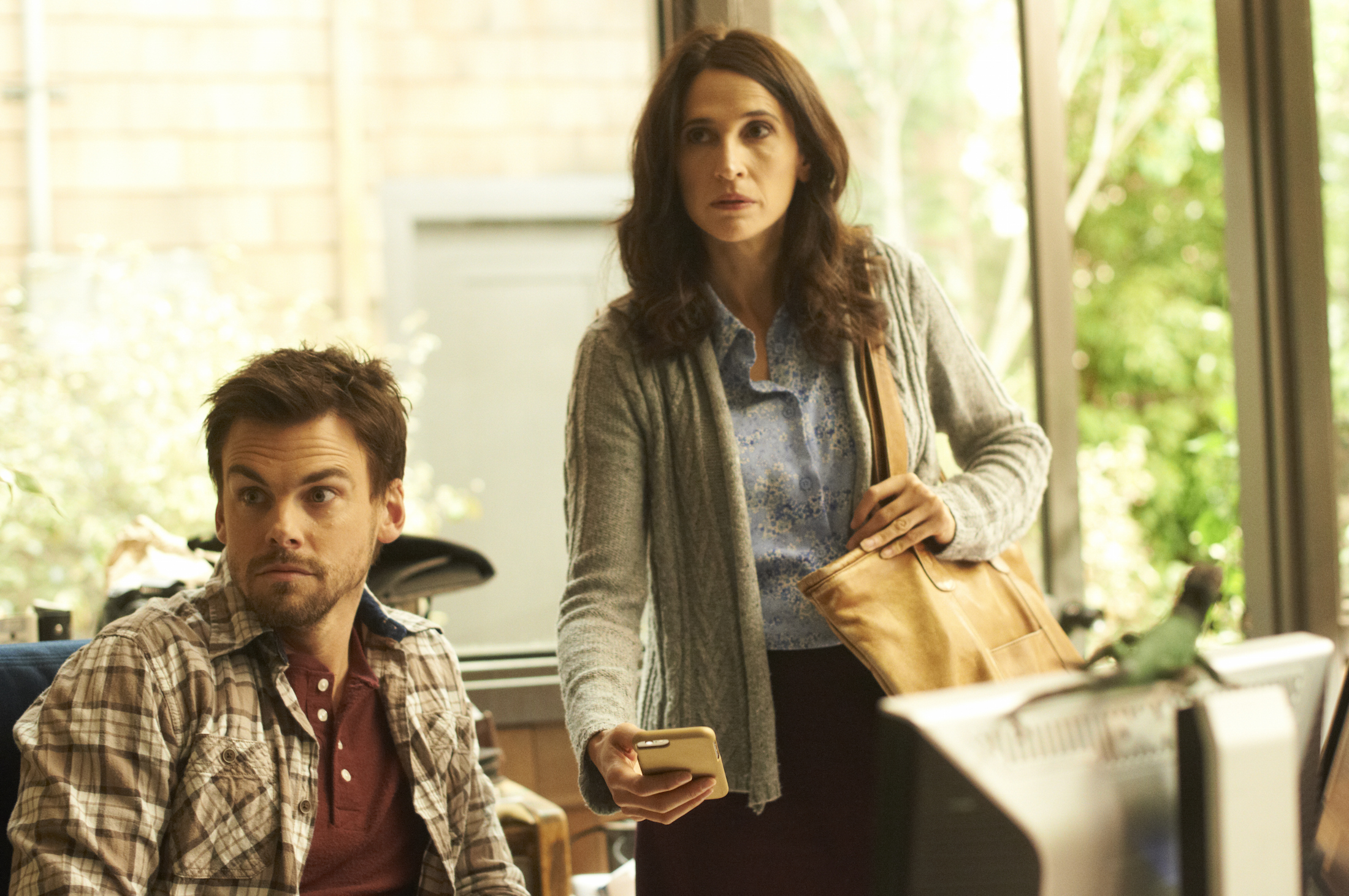 "CASUAL -- ""Mom"" Episode 105 -- Valerie and Alex's mother shows up unannounced. Valerie receives sound advice from an unlikely source. Laura and Michael share a moment. Alex (Tommy Dewey) and Valerie (Michaela Watkins), shown. (Photo by: Greg Lewis/Hulu)"