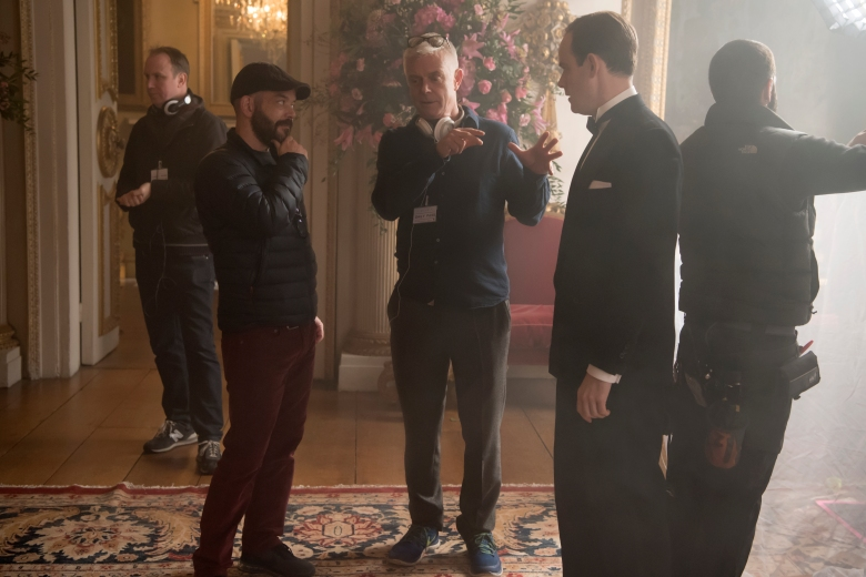 "Cinematographer Adriano Goldman, director Stephen Daldry with Harry Hadden-Paton (Charteris) on the set of ""The Crown"""