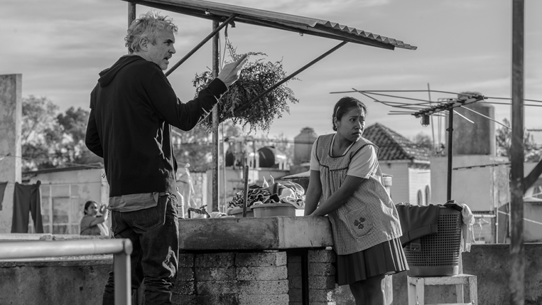 "Director and cinematographer Alfonso Cuaron on the set of ""Roma"""