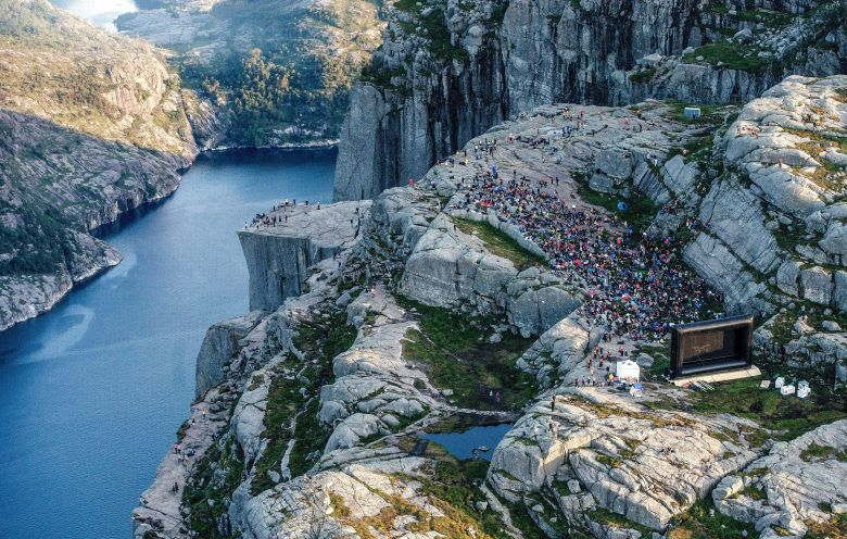 "NORWAY OUTMandatory Credit: Photo by Carina Johansen/EPA-EFE/REX/Shutterstock (9776598a)People gathered in the mountain near Preikestolen (The Pulpit Rock) in Forsand near Stavanger, to see the movie ""Mission: Impossible - Fallout"" in  western Norway, 01 August 2018, Some of the scenes in the movie was filmed at the Norwegian landmark last November.The Pulpit Rock in Forsand featured in Mission Impossible movie, Norway - 01 Aug 2018"